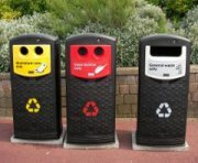 Brightly coloured recycling bins.