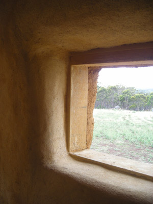 A beautiful view, inside and out! Finished internal strawbale wall.