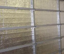 DIY garage door insulation kits are realtively inexpensive and are easy to install.