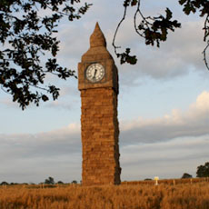 Big Ben, strawbale sculpture built by Snugburys ice-cream in the UK.