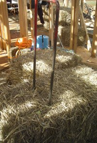 The baling needle, ready to 'split' a bale before inserting into a strawbale wall.