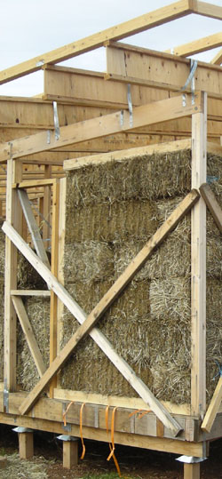 First walls constructed from straw bales on site outside of Melbourne, Australia.